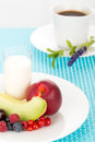 Healthy breakfast with a plate of fresh fruits glass of milk and cup of coffee Royalty Free Stock Photo