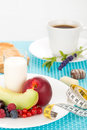 Healthy breakfast with a plate of fresh fruits glass of milk and cup of coffee Stock Photos