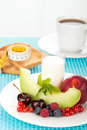 Healthy breakfast with a plate of fresh fruits glass of milk and cup of coffee Stock Images