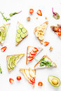 Healthy breakfast with sandwiches set on white background top view
