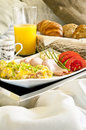 Healthy breakfast served to bed scrambled eggs with tomatoes cucumber and orange juice Royalty Free Stock Photos