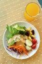 Healthy breakfast set, Fresh vegetable salad and orange juice Royalty Free Stock Photo