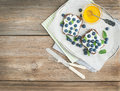 Healthy breakfast set with ricotta, fresh blueberries, honey and Royalty Free Stock Photo