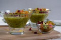 Healthy breakfast, summer dessert with smoothie kiwi, corn flakes and dried fruits in a glassware Royalty Free Stock Photo