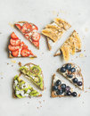 Healthy breakfast wholegrain toasts with cream-cheese, fruit, seeds, nuts Royalty Free Stock Photo