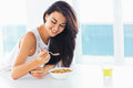 Healthy breakfast. Woman smiling and enjoying morning