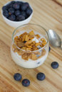 Healthy Breakfast: yogurt with blueberries and corn cereals Royalty Free Stock Photo