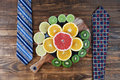 Healthy business lunch concept with ties and citrus fruits Royalty Free Stock Photo