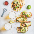 Healthy corn tortillas with chicken, avocado, salsa, limes and beer Royalty Free Stock Photo