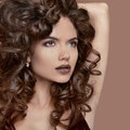 Healthy curly hair. Beauty Makeup. Brunette girl model with fash Royalty Free Stock Photo