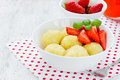 Healthy dessert - dumplings with cheese and strawberry on white Royalty Free Stock Photo