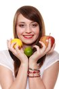 Healthy diet and nutrition girl holding fruits smiling apple lemon lime isolated on white happy woman recommending food Stock Image