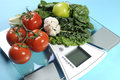 Healthy diet and weight loss concept with healthy vegetables and diet scale. Royalty Free Stock Photo