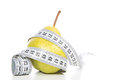 Healthy diet weight loss concept with pear and tape measure on a white background Royalty Free Stock Photography