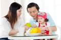 Healthy eating concept asian parent and daughter enjoying tea time Royalty Free Stock Photos