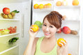 Healthy eating concept diet beautiful young woman near the refrigerator with food fruits and vegetables asian model Royalty Free Stock Image