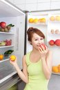 Healthy eating concept diet beautiful young woman near the refrigerator with food fruits and vegetables asian model Stock Images
