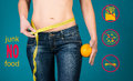 Healthy eating, diet and fitness concept. No junk food. Healthy female body with orange and measuring tape.