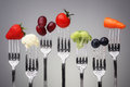 Healthy eating fruit and vegetable of silver forks against a grey background concept for dieting and antioxidant Royalty Free Stock Images