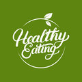 Healthy Eating hand written lettering logo, label, badge, emblem with leaves.