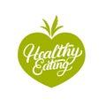 Healthy Eating hand written lettering logo, label, badge, emblem on vegetables background.