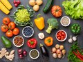 Healthy eating ingredients: fresh vegetables, fruits and superfood. Nutrition, diet, vegan food concept Royalty Free Stock Photo