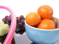 Healthy eating orange fruits on a scale with grapes of wine Stock Image