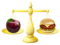 Healthy eating scales decision concept of an apple and burger on a set of Stock Images