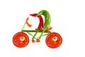 Healthy eating. Two little funny peppers on bicycle. Royalty Free Stock Photo