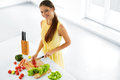 Healthy Eating. Woman Cooking Vegetable Salad. Diet, Lifestyle. Royalty Free Stock Photo