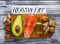 Healthy fat salmon, avocado, oil, nuts Royalty Free Stock Photo