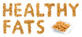 Healthy fats peanuts word text white background the written composed of and a small container with inside Royalty Free Stock Photos