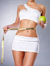 Healthy female body with apple and measuring tape. Royalty Free Stock Photos
