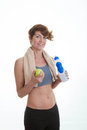 Healthy fit middle aged woman with water and apple Stock Photography