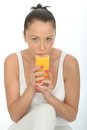 Healthy Fit Young Woman Drinking a Glass of Fresh Orange Juice Royalty Free Stock Photo