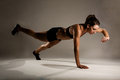 Photo : Healthy Fitness Woman doing a One Handed Pushup curls white drinking