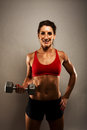 Healthy Fitness Woman Showing Her Muscles Royalty Free Stock Image