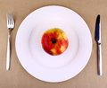 Healthy food apple white plate fork knife top view Stock Photos