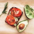 Healthy food avocado and tomatoes Royalty Free Stock Images