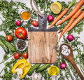 Healthy food background with colorful various vegetables for tasty cooking around the cutting board  place for text,frame on woode Royalty Free Stock Photo