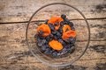 Title: Healthy food background. Dried fruits on wood table