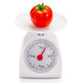 Healthy food on balance scale Royalty Free Stock Photo