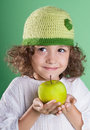 Healthy food beautiful little girl with green apple in hands Royalty Free Stock Photography