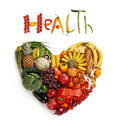 Healthy food choice symbol represented by foods in the shape of a heart to show the health concept of eating well with fruits and Stock Photos