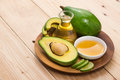 Healthy food concept. Fresh organic avocado oil with honey on ta Royalty Free Stock Photo