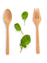 Healthy food concept fresh organic green leaves with wooden fork Royalty Free Stock Photo