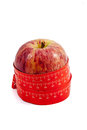 Healthy food concept a tape measure around an apple on white background Royalty Free Stock Image
