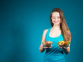 Healthy food consept slim healthy girl with vegetables and cereal young woman fresh salad on blue background Royalty Free Stock Photo
