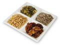 Healthy food for dety seeds and nuts on a white plate Stock Image