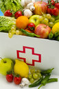 Title: Healthy food. First aid box filled with fresh fruits and vegetab